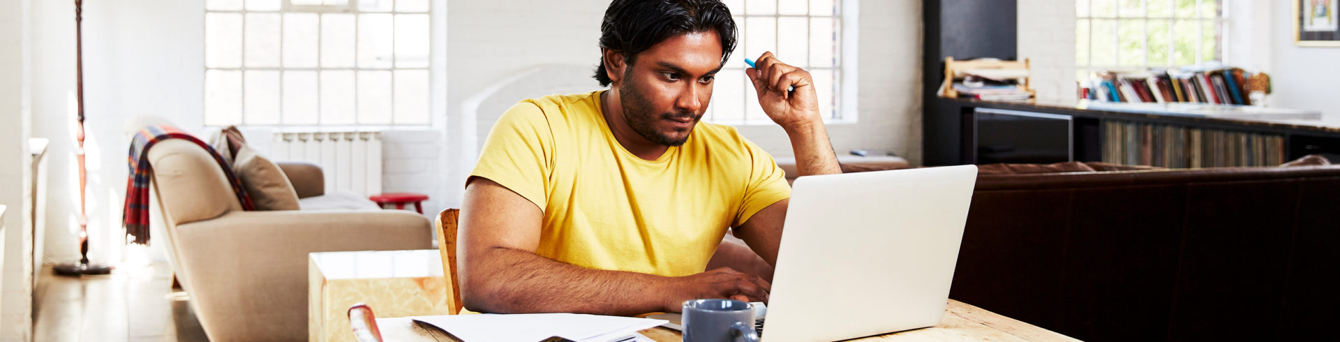 Image of man working on his laptop